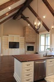 open kitchen great room with fireplace in the coenwr cathedral ceiling lighting ideas