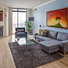 bachelor pad living room ideas with grey simple sectional sofa furniture and glass modern coffee table bachelor pad furniture