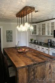 rustic kitchen island: mason ball jar light and rustic island nest of bliss