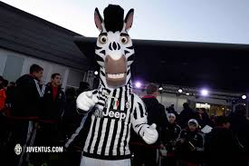 festive fun for the j academy juventus com faces present were academy director stefano braghin and senior squad coach massimiliano allegri as well as the entirety of the tuscan s backroom team