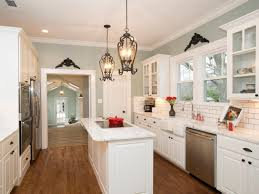 best ideas about cottage kitchen tiles cottage kitchen features refinished hardwood floors white cabinets a subway tile backsplash and a pretty light blue paint job description from i searched for