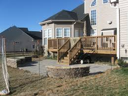 outdoor fireplace paver patio: deck and stone patio with firepit and retaining walls by archadeck of charlotte