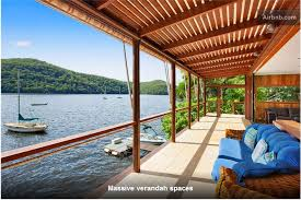 this three level home situated on the waters edge is a hidden gem with water views from every room in the house of pittwater one of sydneys most beautiful airbnb sydney