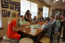 How the Duggars     custom home separates their sons from their    Scandal hit family  Kelly is pictured speaking   some of the Duggars