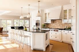 traditional kitchen with breakfast bar stone tile crate and barrel delta aluminum bar stool aluminum crate barrel