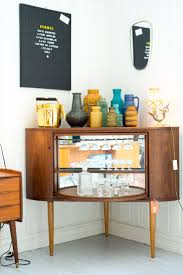 mid century modern bar is a corner liquor cabinet that resembles some of these vintage tv console conversions at stock in this unit spins on a lazy built home bar cabinets tv