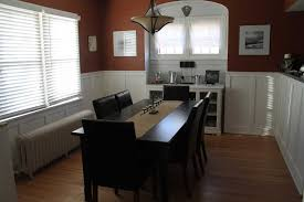 astonishing dining room ideas and wainscoting design with traditional expanding black wood dining table design and black wood dining room