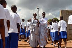 photos rwanda genocide 20th anniversary com a young w and a young man hold the kwibuka flame of remembrance during a procession