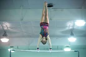 dynamo dominoes lead senior laden northfield gymnastics dupay competed on the high bars during a meet last week she is a two time state champion in all around