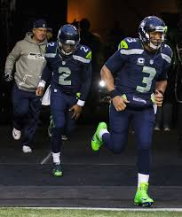 thomas rawls breaks through sets a seahawks playoff record for russell wilson heads out on to the field for saturday s wild card game detroit