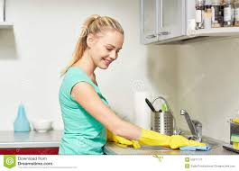 clean kitchen: happy woman cleaning table at home kitchen