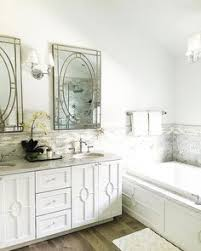 bathroom features gray shaker vanity: white and gray bathroom features a white double vanity fitted with geometric