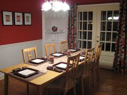 dining room wall decorating ideas: interesting red accent wall color combined by dining room wall decor with chairs and elongated table