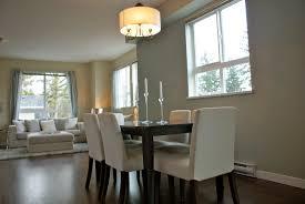 dining table parson chairs interior: la jolla parsons chairs with dark wood dining table and drum pendant lighting for elegant dining