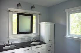 sliding bathroom mirror: bathroom remodel using sliding mirror to preserve natural light