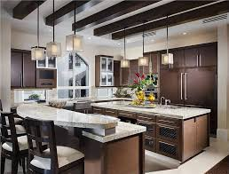 medium sized kitchen with two islands one island is 2 levels for an elevated eat spacious eat kitchen