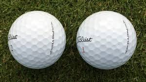 Image result for two golf balls on a green