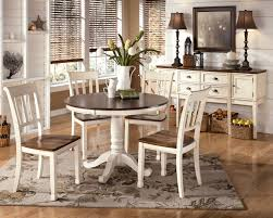 black and white dining table set: whitesburg  piece round dining table set in brown white by dining rooms outlet
