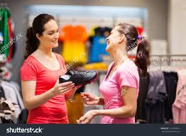 shop assistant helping customer choosing sports stock photo shop assistant helping customer choosing sports shoes