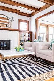 fascinating craftsman living room chairs furniture: white painted brick natural wood trim neutral chairs layered rugs living room