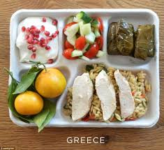 photos of school lunches served around the world reveal how meager greek school lunches feature baked chicken orzo stuffed grape leaves salad of cucumber
