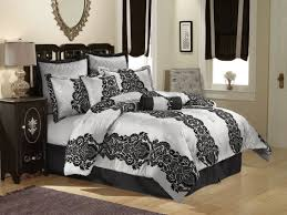 contemporary french bedroom design with black off white silver bedding comforter large silver tufted pillows black white style modern bedroom silver