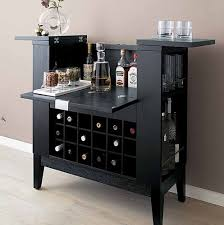 glass for stirred drinks a two part boston style shaker for shaken drinks a bar spoon ice cracker and measuring device old tv cabinet details add built home bar cabinets tv