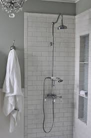 golden bathroom shower column faucet wall: i like the neutral wall color picked up in the nook color and i like the larger nook diy tall shower niche tutorial with exposed shower mosaic glass and