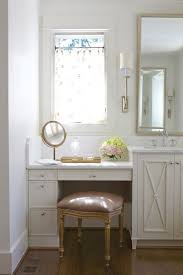 built bathroom vanity design ideas: pretty bathroom with a mauve velvet french vanity stool tucked below a built in ivory