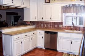 beautiful white kitchen cabinets:  beautiful white kitchen backsplash tile ideas white lacquered wood kitchen cabinet hardware brown tile ceramic backsplash