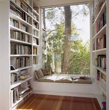 large bay window with frameless glass window bench with pillows large bookshelves in left and right bay window furniture