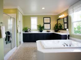 bathroom designs luxurious: large luxury bathroom with light green walls dark cabinetry and white bathtub