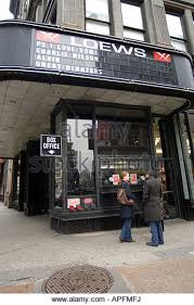 moviegoers purchase tickets a the box office of the loews 19th street multi plex theater in art deco box office loew