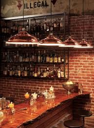 be sure to check out the wood slab used on this bar top along with rejuvenations bar top lighting