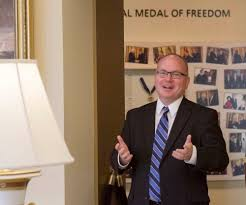 alan lowe director of the george w bush presidential library and museum stands bush library oval office