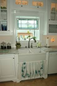 sink windows window love: beautiful leaded window above the sink the only things i would change about this kitchen are the cabinet hardware and the curtain below the sink