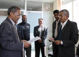 patan academy of health sciences blog archive news archieve dr kedar prasad baral being sworn in as the rector by the vice chancellor amid the pahs executives and members