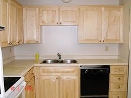 cheap kitchen cupboard: cheap unfinished kitchen cabinets cream curved wooden computer desk dark brown wooden countertop green white wall paint on the room with
