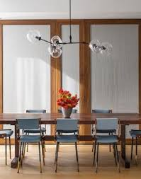 amusing dining space design in ninth avenue duplex company with several grey colored back chairs and baya park company office design