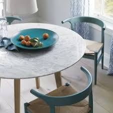 round white marble dining table: jensen dining table crate and barrel