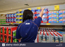 a store assistant stocking shelves in aldi supermarket stock photo a store assistant stocking shelves in aldi supermarket
