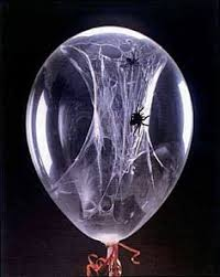 love halloween window decor: love this before blowing up the balloon squirt some white glue inside and place a
