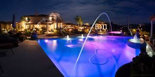 purple lighting in the swimming pool design gives a beautiful effect swimming pool beautiful lighting pool