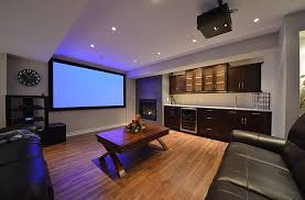themed family rooms interior home theater: home theater ideas basement living room black track lamp awesome wood wall theme cone wall mount lamp leather sofa furniture antique table lamp