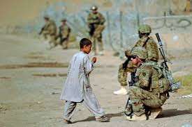 u s department of defense photo essay u s army sgt brian reid talks an afghan child during a dismounted patrol in