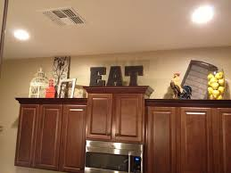 nacs above kitchen cabinet lighting
