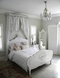 white and grey shabby chic bedroom with a crystal chandelier chic shabby french style distressed white