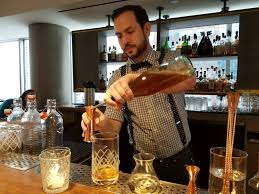 chicago s baptiste bottle a bourbon destination bar manager john making me the a curtsy and a bow