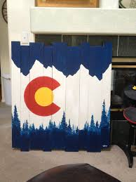 these are custom hand painted wood pieces that we make and sell mountain and tree colorado flag design email for more information and pricing artistic wood pieces design