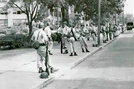 「Arkansas Governor Orval Faubus had surrounded the school with National Guard troops」の画像検索結果